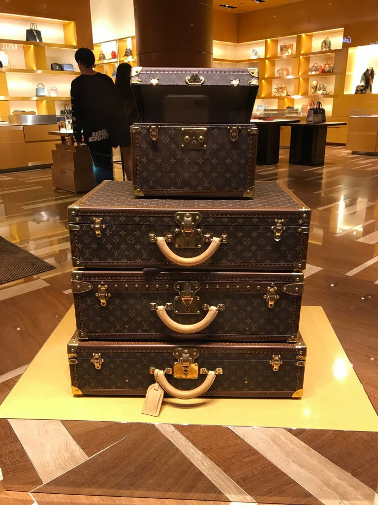 Louis Vuitton luggage bags stacked up